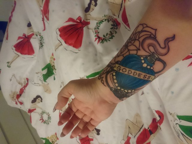 tattoo, lily-tattoo, floral-tattoo, tattoo-flowers, tattoo-coverup, cover-up, tattoo-by-thor, thor-gratts, mad-tatters, perfume-bottle, vintage-style-tattoo, peacock-feather, quarter-sleeve, wrist-tattoo, flowers-bottle-feather-tattoo