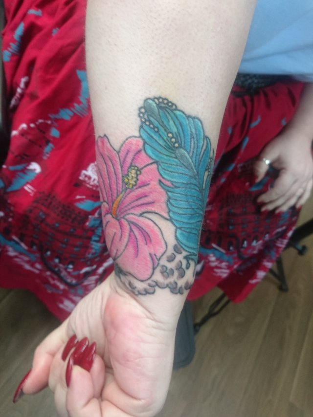 tattoo, lily-tattoo, floral-tattoo, tattoo-flowers, tattoo-coverup, cover-up, tattoo-by-thor, thor-gratts, mad-tatters, perfume-bottle, vintage-style-tattoo, peacock-feather, quarter-sleeve, wrist-tattoo, flowers-bottle-feather-tattoo, camellia, hibiscus, wrist-cuff